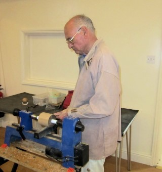 Geof Horsfield was turning a sphere using his sphere turning tool
