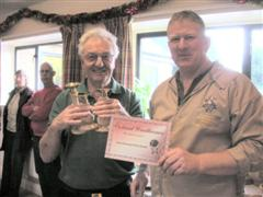 The turning of the month winner Graham Holcroft received his certificate from Tony Handford