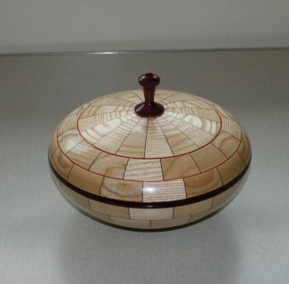 Segmented lidded bowl won turning of the month certificate for Chris Withall