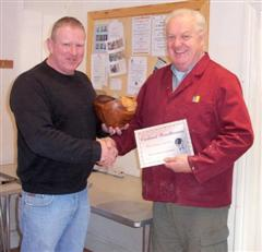 The monthly winner Tony Handford received his certificate from Chris Eagles