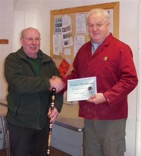 Pat Hughes receives the highly commended certificate from Chris Eagles