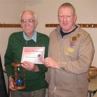 The monthly winner Bernard Slingsby received his certificate from Tony Handford