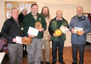 Greg Morton presents the February 2012 certificates to Howard Overton Brian Love Steve Tredwell and Keith Leonard