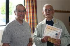 Wally Green presented with his certificate by Dennis Hill