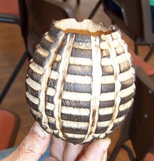 A small hollow vessel decorated with an arbotec
