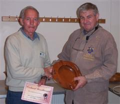 The monthly winner David Ward receiving his certificate from Stuart Mortimer