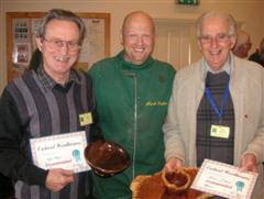 Geoff Hunt and Denis Ireland get commended certificates from Mark Baker