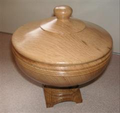 Lidded bowl with square base by Pat Hughes