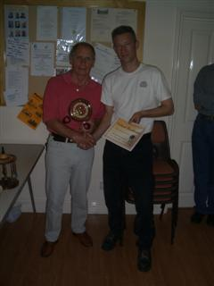 Howard Overton being presented with his certificate by Jimmy Clews