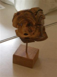 Multi faced cube sweet chestnut burr on pedestal by John Holmes