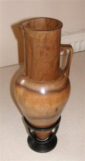 Walnut jug in an ebonised stand by Pat Hughes